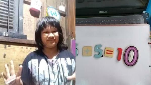 Une petite fille porteuse de handicap réalise un exercice de mathématiques avec son éducatrice en visio